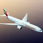 emirates boeing hovering above the sea