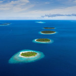 islands of maldives , a chain of islands aligned in a row