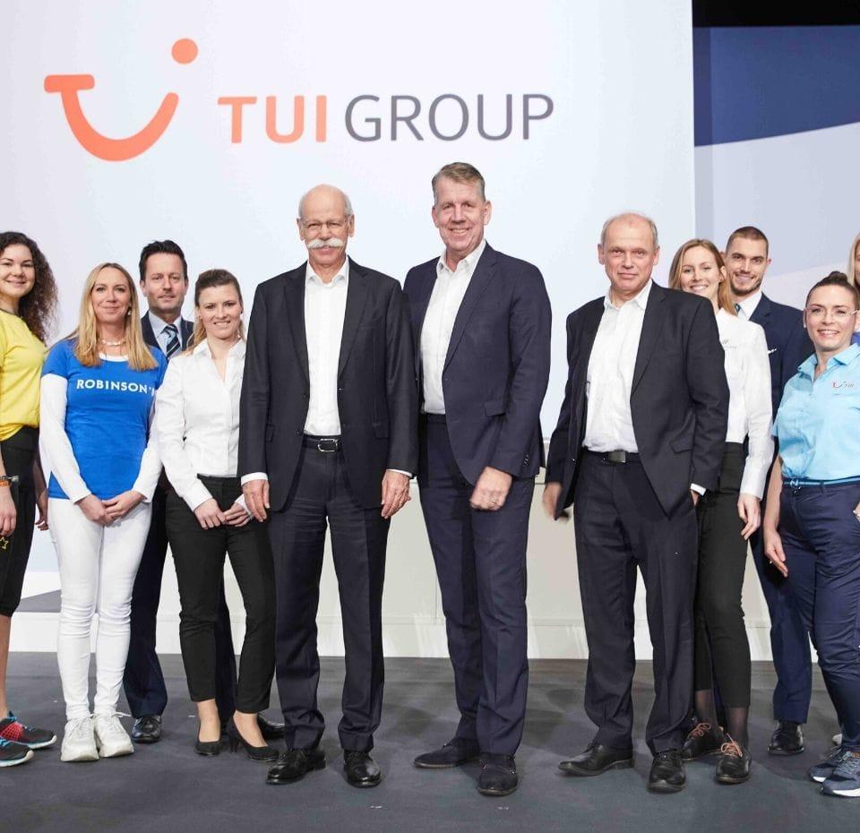 TUI Group annual meeting photo taken infront of TUI Logo