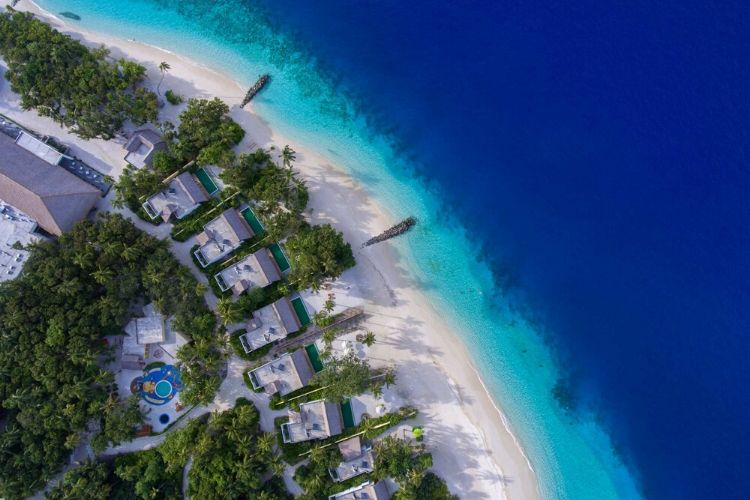 New opened resort Emerald Maldives Ariel view of the shades of blue , white sandy beaches and the Eco greenery