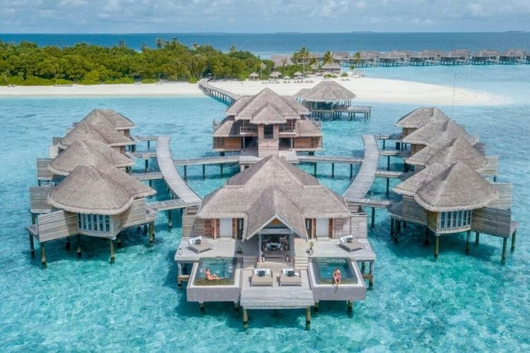 Vakkaru Maldives Ariel view from the water villa in the turquoise lagoon.