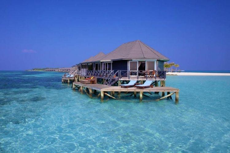 Kuredu Resort Maldives water villas in crystal clear waters.