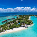 Arial view of Sheraton Maldives with white sandy and turquoise lagoon.