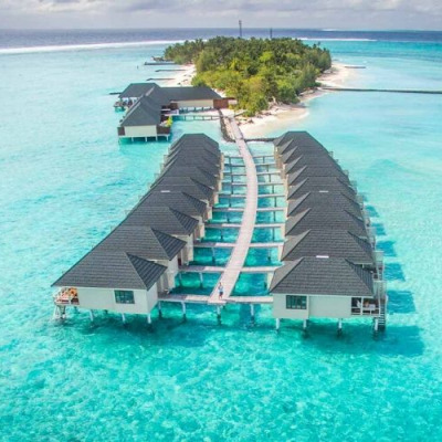 Ariel view of Summer Island Maldives over the water bungalows.