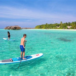 Guests enjoying the crystal clear waters of Maldives in Veligandu Maldives.