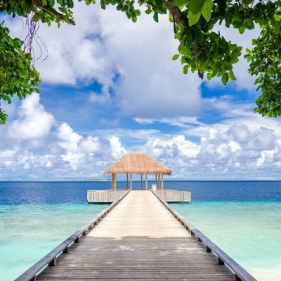 Amilla Maldives Resort bridge with blue ocean and turquoise waters