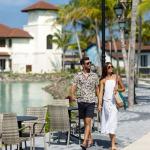 guests walking by the marina at crossroads maldives