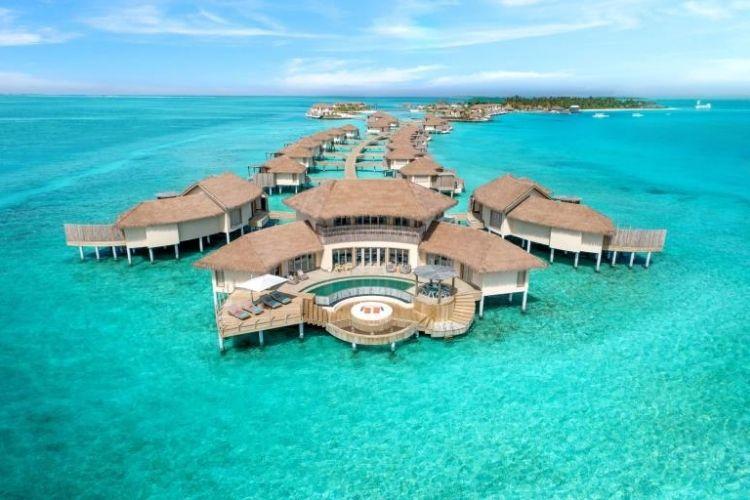 over water villas at maldives luxury resort overlooking the lagoon