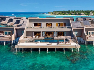 Vommuli resort's overwater villas surrounded by beautiful lagoon