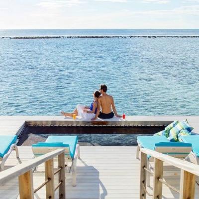 couple enjoying their stay at kandooma Maldives