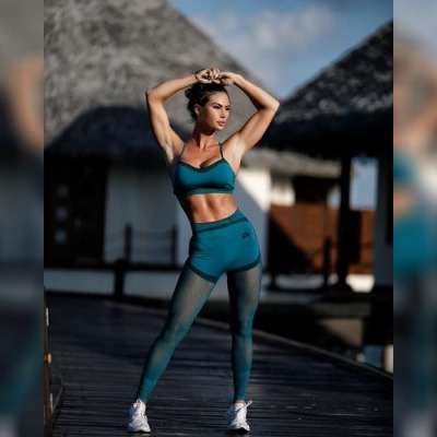 Katelyn Runck posing in the Maldives