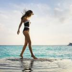 person on top of the pool at Mövenpick Resort Kuredhivaru Maldives