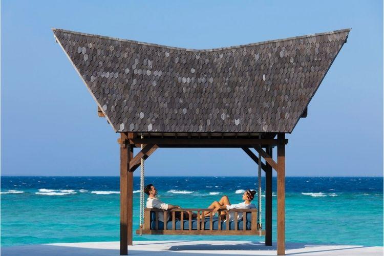 Movenpick Resort Kuredhivaru Maldives, guests enjoying the tranquil nature of the island.