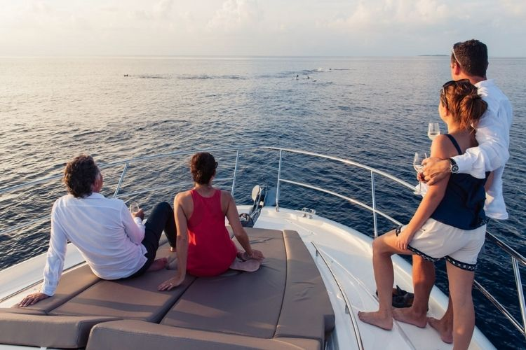 Tourists on a dolphin cruise at velaa private island in the Maldives