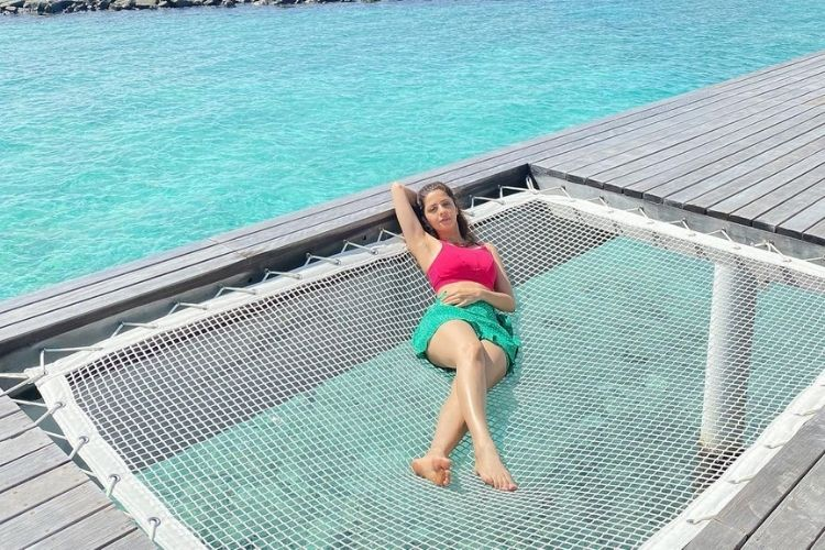 Vedhika relaxing on a hammock in the Maldives